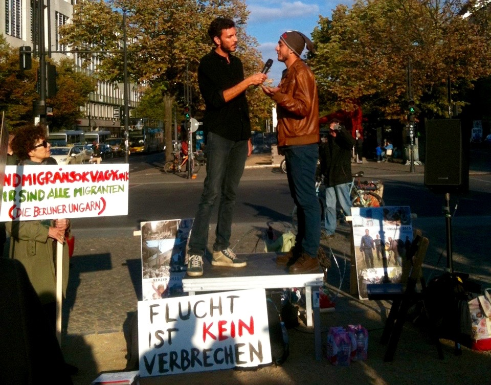 Ahmed speaking at a demonstration for refugee rights in Berlin. Photo by Aki Naito.